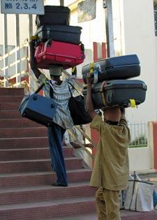 men-carrying-too-much-carryon-luggage