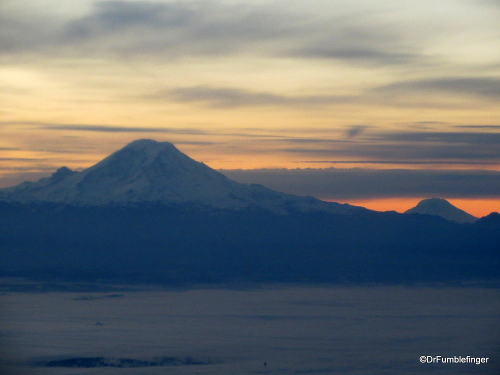Sunrise over Mt. Rainier(L) and Mt. St. Helens (R background).  Washington state
