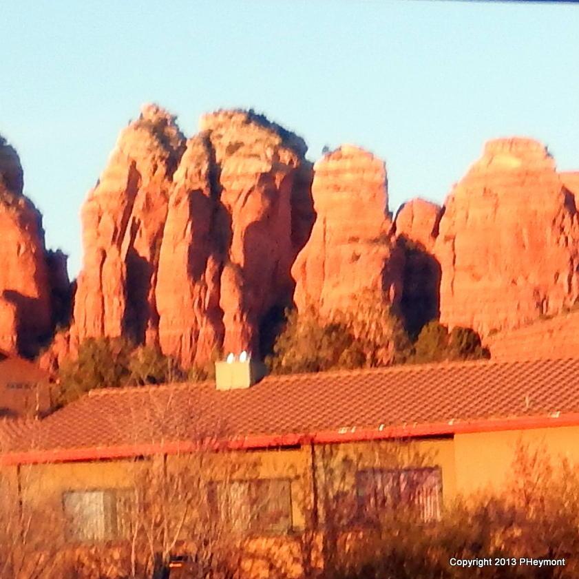 Sedona AZ-Red Rocks rise above townscape