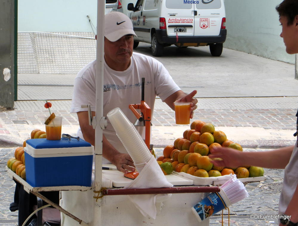 San Telma, Argentina.  Orange Juice doesn't get any fresher than hand squeezed by this street vendor