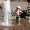 Child delighted with pool, Vail, Colorado