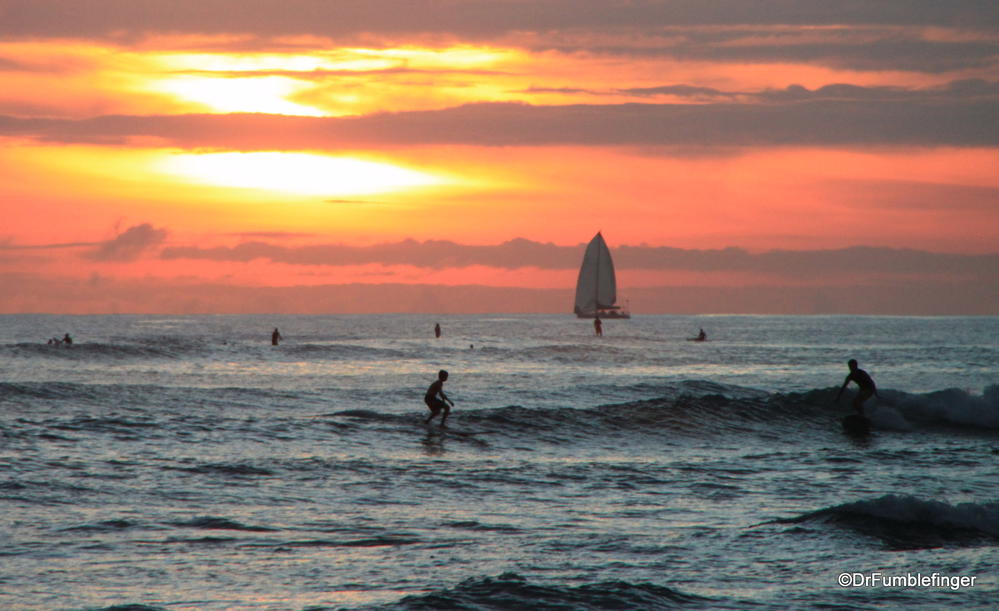 Surfing at sunset, Waikiki beach