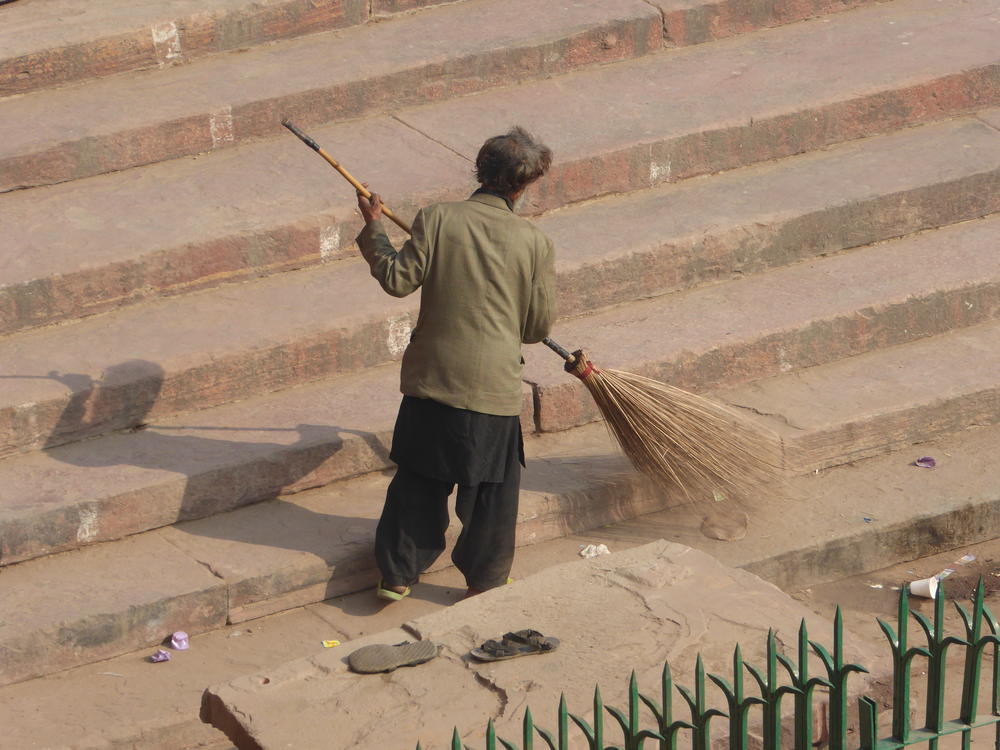 Sweeping the steps of the  Jama Jasjid, Old Delhi