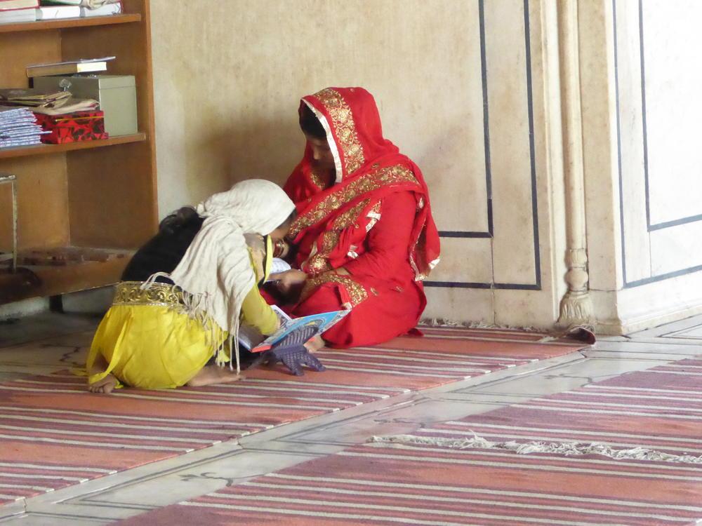 Studying the Koran at  Jama Masjid, Old Delhi