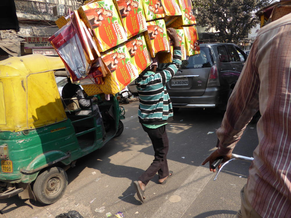 A typical sight in Old Delhi -- bad traffic, congestion and people carrying heavy loads