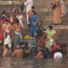 Pilgrims take a morning plunge into the purifying waters of the Ganges River, Varanasi