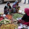 Streetside produce vendors and shoppers, Jaipur