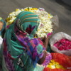 Selling flowers for offerings in front of a Hindu temple