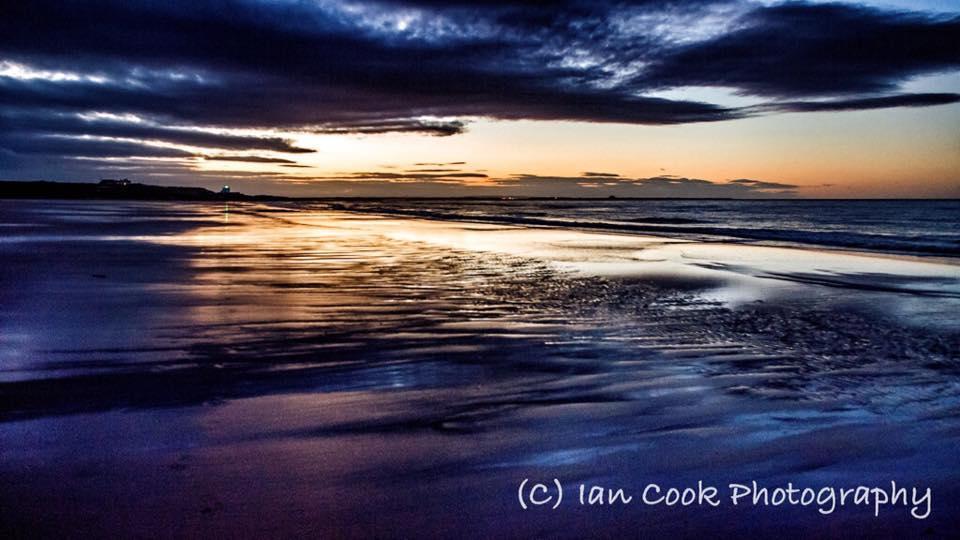 Sunset Bamburgh Beach Northumberland.