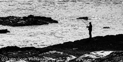 Fisherman, Cullernose Point, Northumberland, UK.