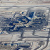 Calgary International Airport shrouded in snow.  The new International Terminal expansion is at the top of the image