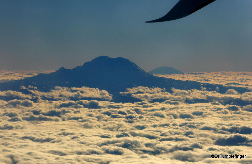 Mt. Rainier and Mt. St. Helen's (in the distance) penetrating the cloud layer
