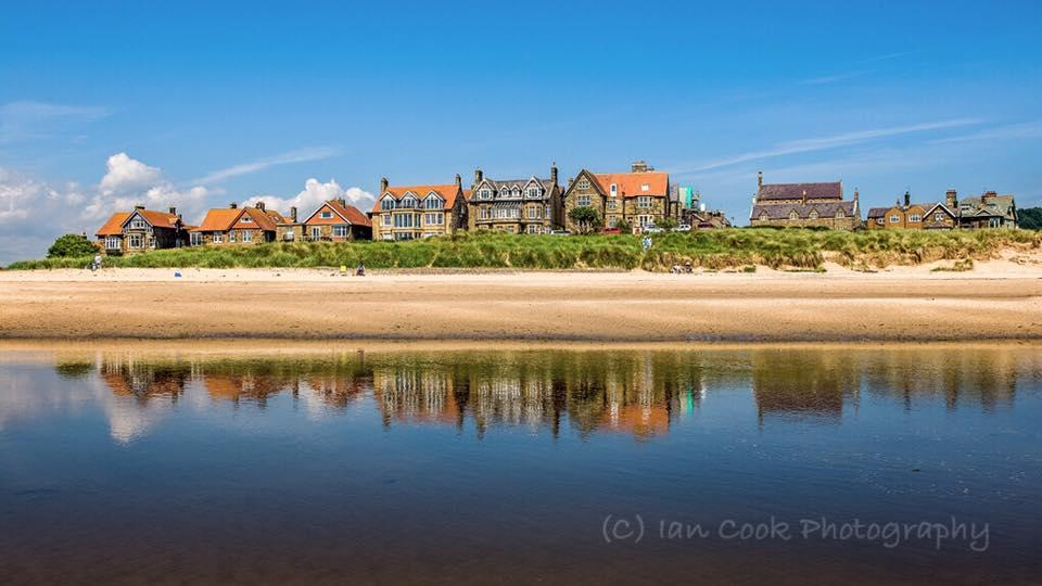 A rather tropical day at Alnmouth Northumberland! The houses reflected in the river Aln at low tide.