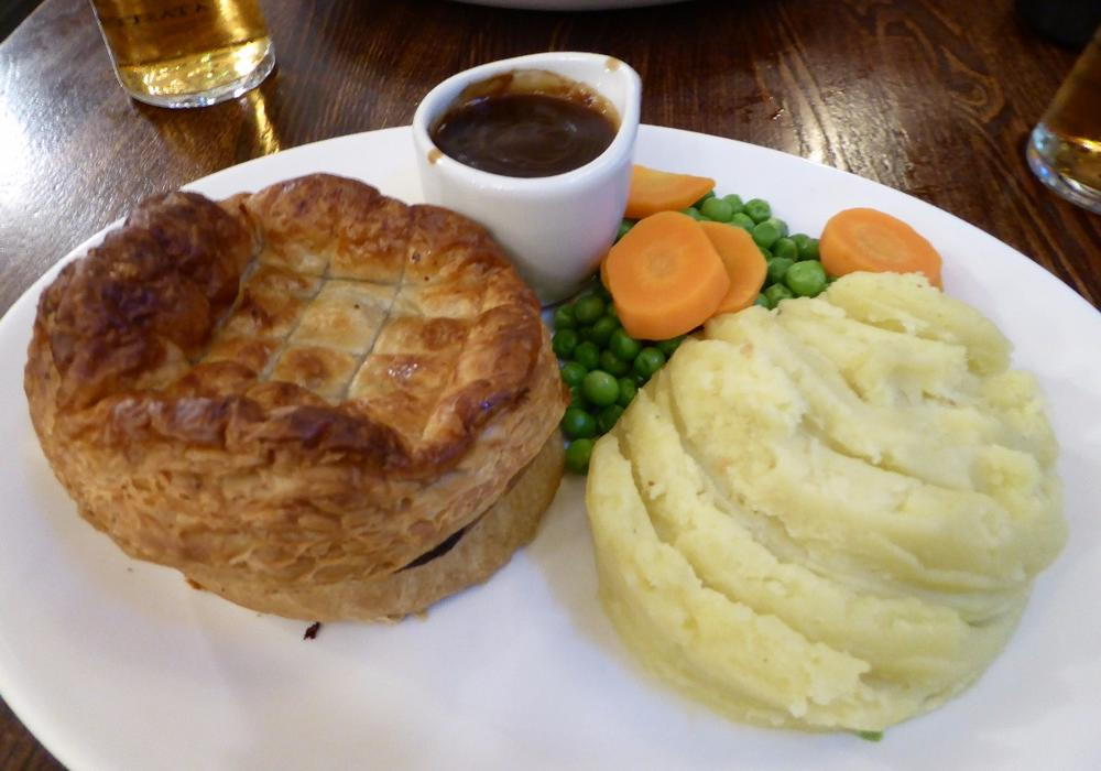 British pub grub.  Meat pie, mashed potatoes, vegetables smothered in gravy