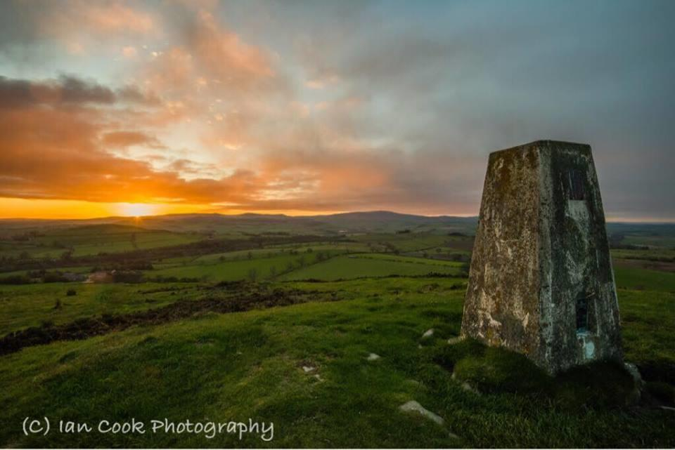 Sunset from the summit of Titlington Pike Northumberland.