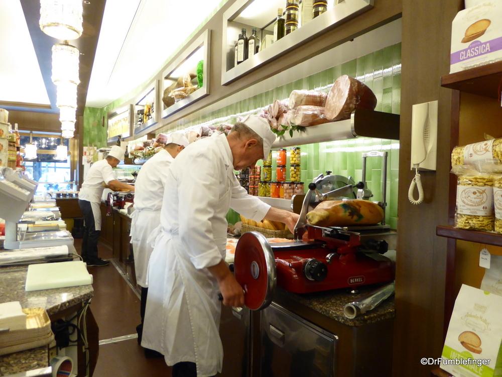 Butcher shop, slicing Parma ham, in Milan
