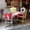 A table awaits them.  A clever way to draw attention to your restaurant, Brera neighborhood, Milan