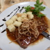 Bled dinner of beefsteak, gnocchi and onions -- very tender and tasty