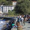 School children skipping stones into the Adriatic Sea