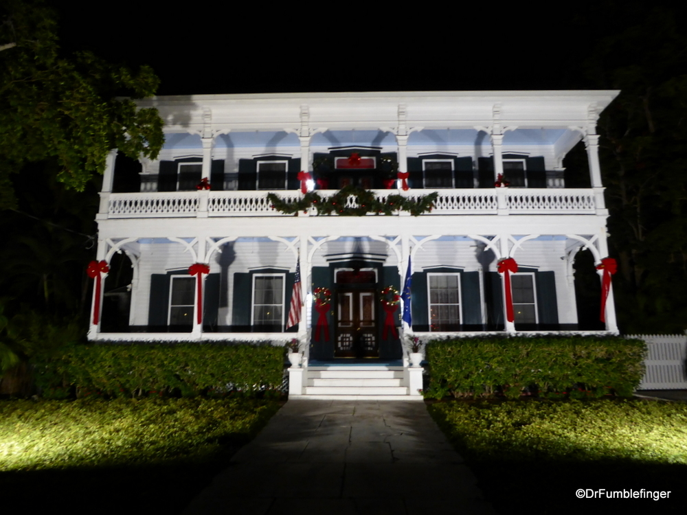 Historic home in Key West, lite up at night.