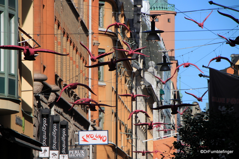 Flock of geese over Gamla Brogatan, a Pedestrian Mall, Stockholm