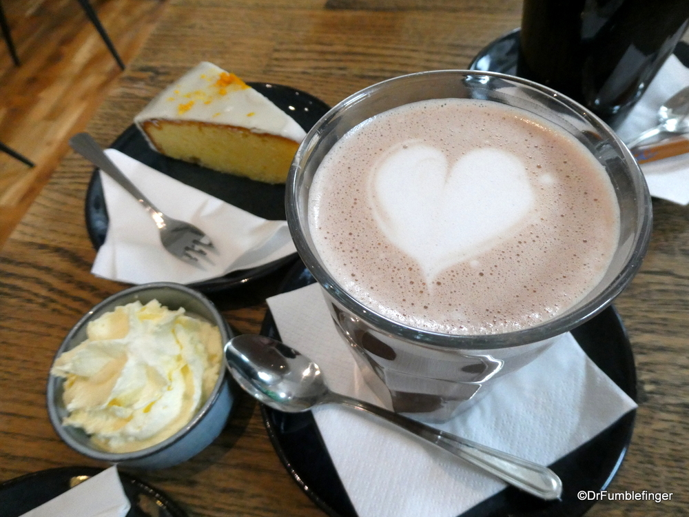 A cup of hot chocolate and slice of lemon cake hit the spot on a wet cool day