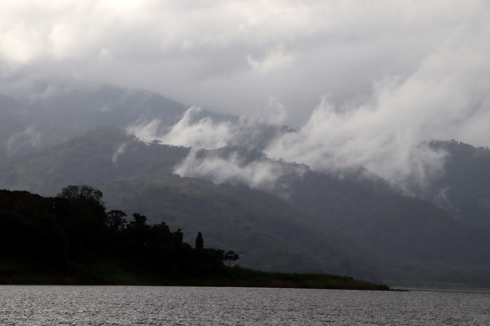 Low hanging clouds and drizzle over Lake Arenal, Costa Rica