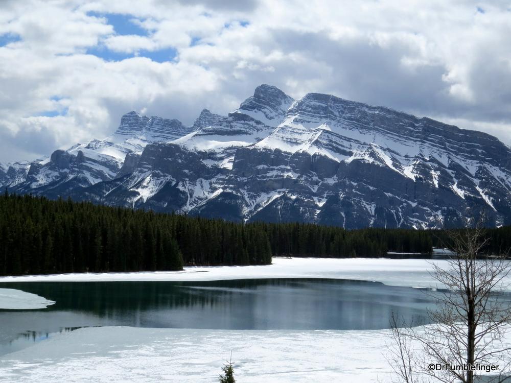 Mt. Rundle framing a half melted Two Jack Lake, Banff National Park